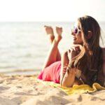 sunbathing aging app - woman on beach