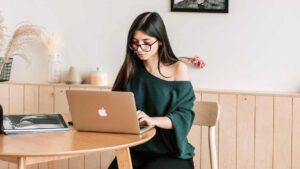 fake news stories - woman reading laptop